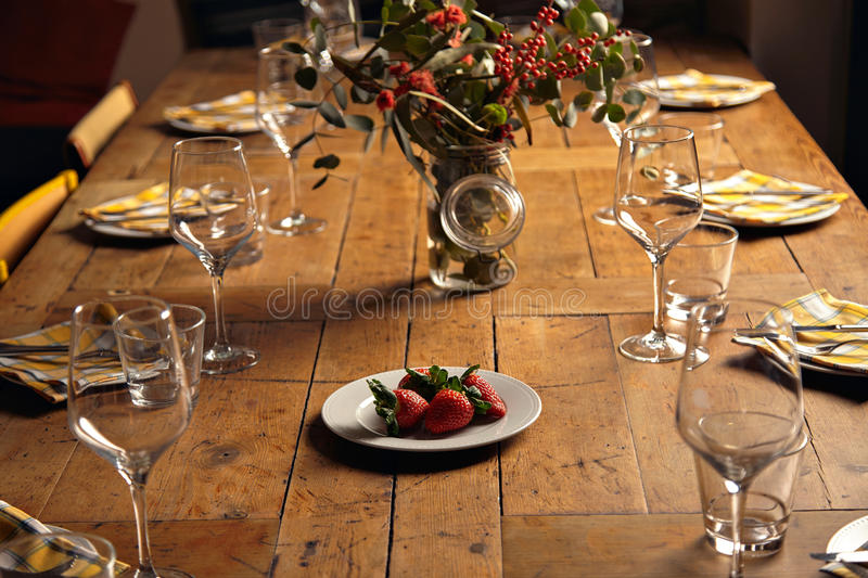Plate With Big Fresh Strawberries Isolated In Center Of Served For Holiday Dinner  Table, Between Empty Dishes And Wine Glasses, In Front Of Big Jar With ...