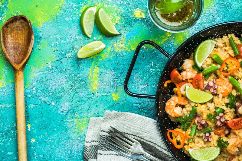 Serving healthy seafood spanish paella in pan.  stock photos