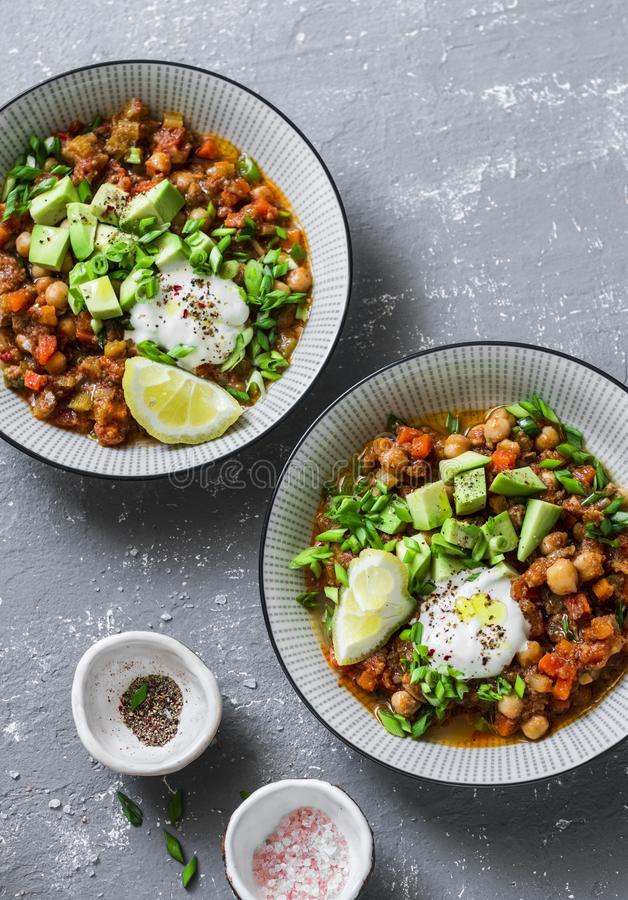 Serving lunch vegetarian buffalo chickpea chili with mushrooms on a gray background, top view. Healthy vegetarian food stock photo