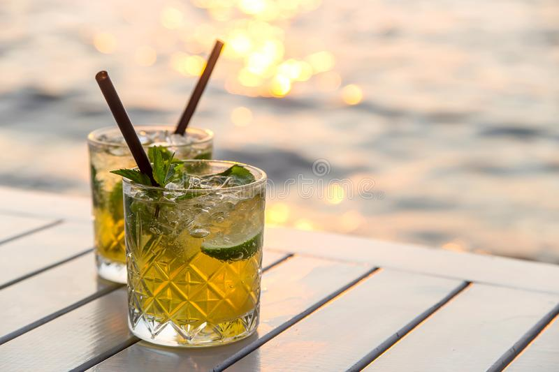 Serving mojito in a street cafe as a summer vacation stock photography