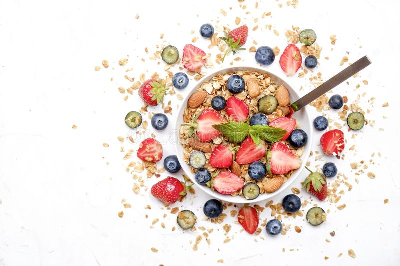 Ceramic granola bowl, assorted ingredients on table. Healthy nutritious breakfast with vegan yogurt, raw fruits, nuts and cereals. stock photos