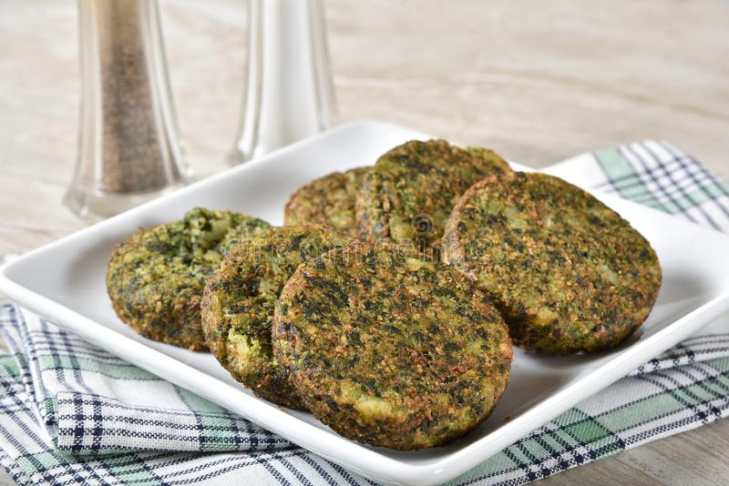 Serving plate of spinach cakes royalty free stock photography