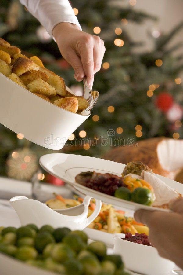 Download Serving Roast Potatoes At Christmas Lunch Stock Image - Image: 5607301