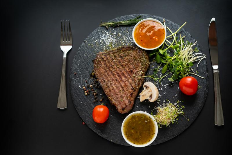 Serving of seasoned grilled beef steak royalty free stock photos