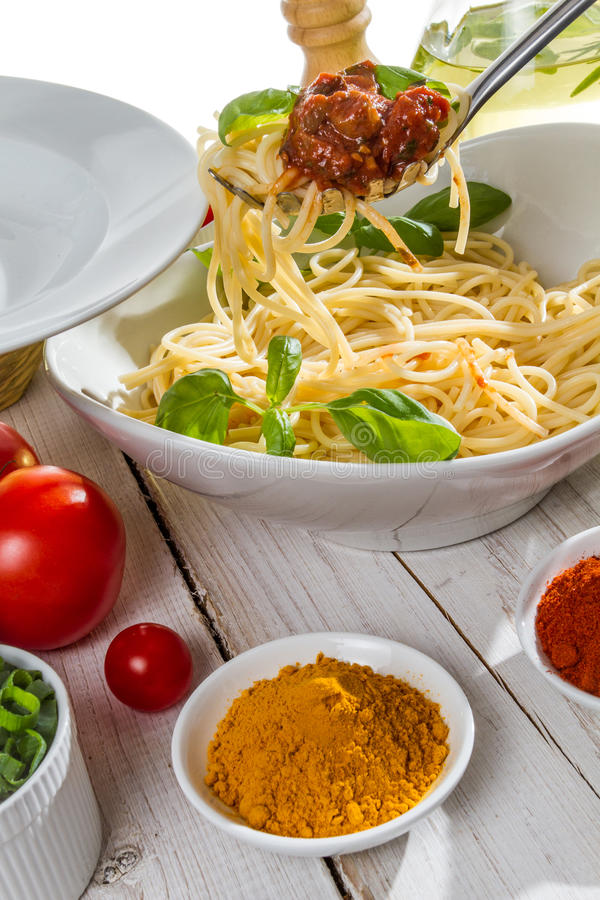 Serving of spaghetti on a plate stock photos