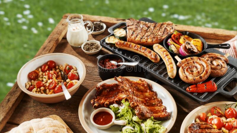 Serving of spicy pork ribs and salads royalty free stock images
