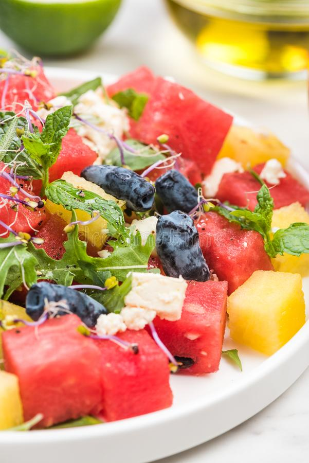 Serving Summer Fresh Watermelon Salad with Fresh Mint and Lime Juice royalty free stock photography