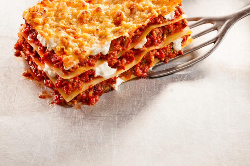 Serving of tasty traditional Italian lasagne royalty free stock images