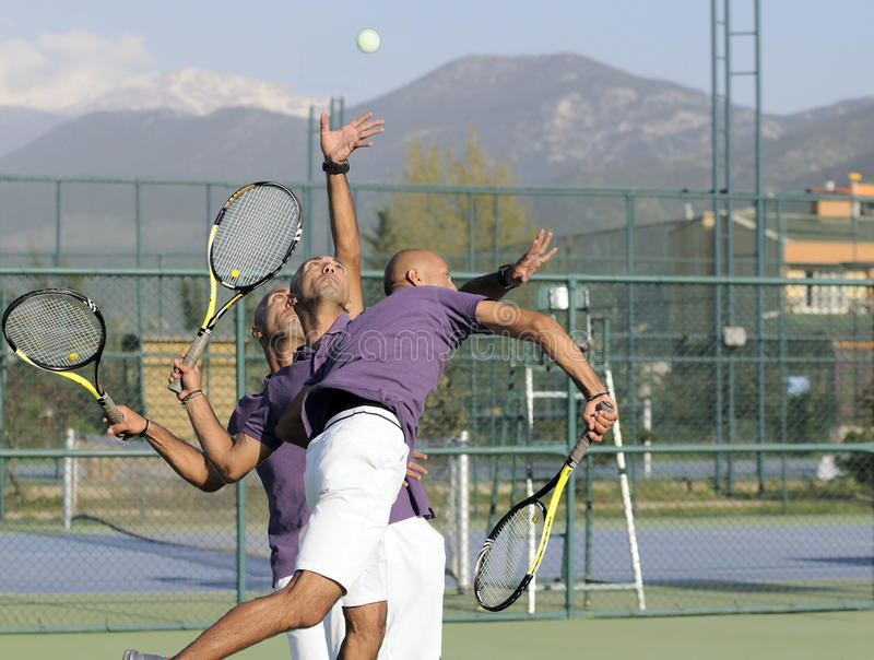Serving a tennis ball royalty free stock photo