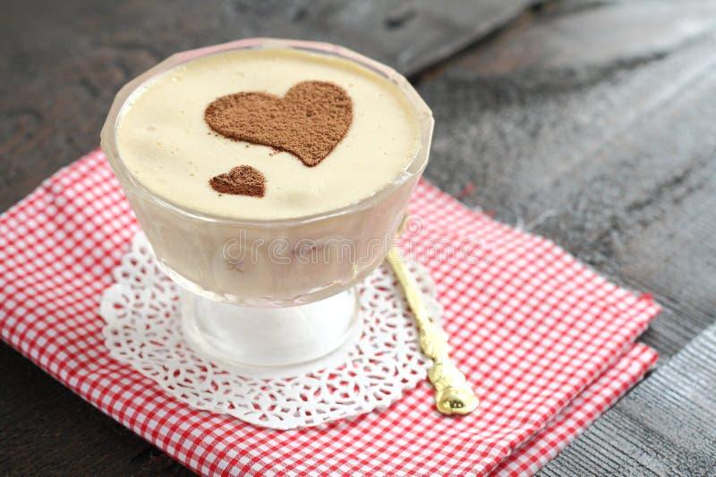 Serving tiramisu dessert heart royalty free stock images