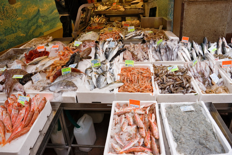 Servizio di pesci italiano immagine stock