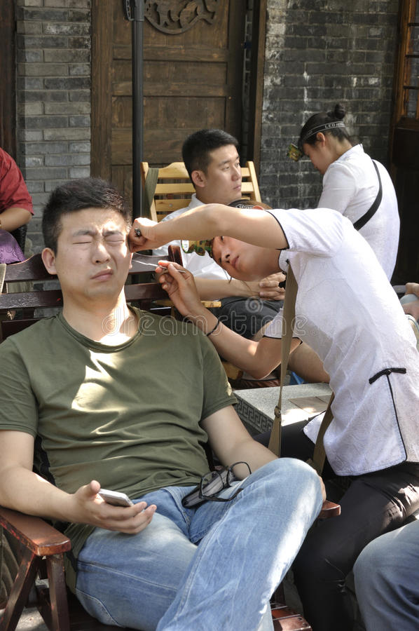 Servizio di pulizia dell'orecchio fotografia stock