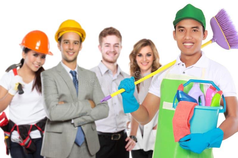 Servizio maschio di pulizia ed altri professionisti fotografia stock libera da diritti