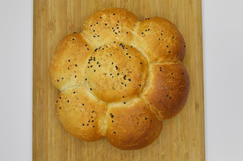Sesam en zwart zaad op vers gebakken heet brood stock foto's