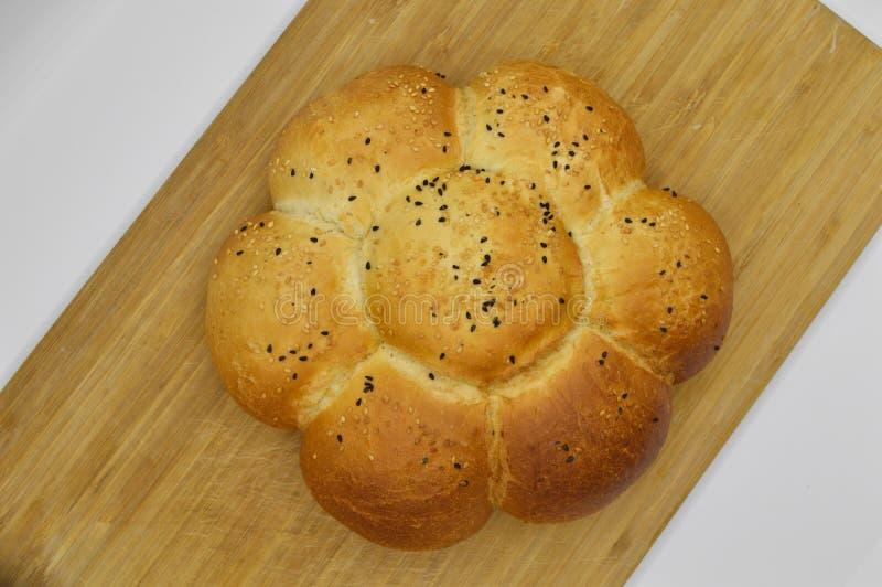Sesam en zwart zaad op vers gebakken heet brood royalty-vrije stock afbeeldingen