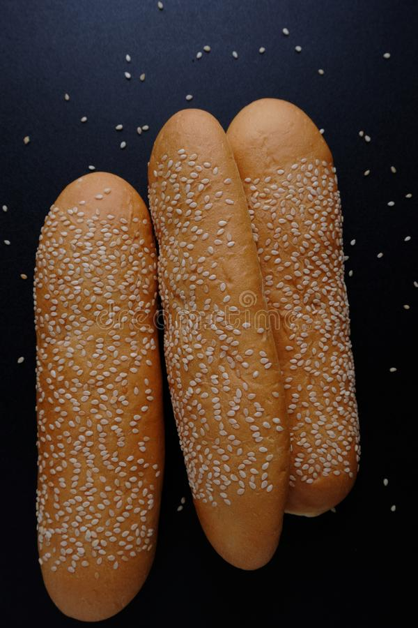 Sesame bread on black floor stock image