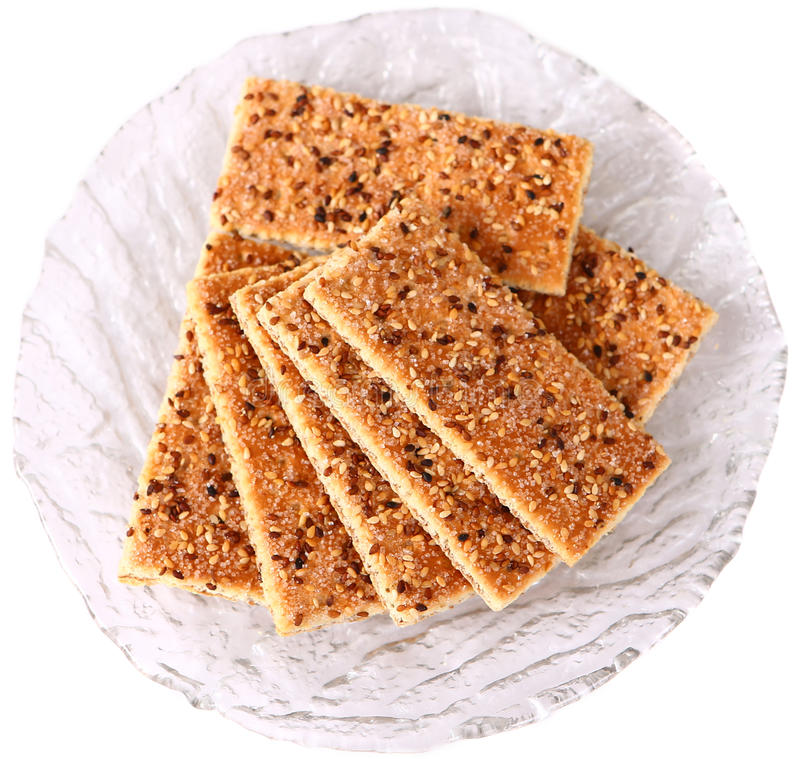 Sesame cakes with cocoa and sugar royalty free stock image