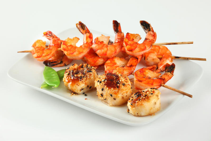 Sesame ginger scallop and Shrimp Skewers stock images
