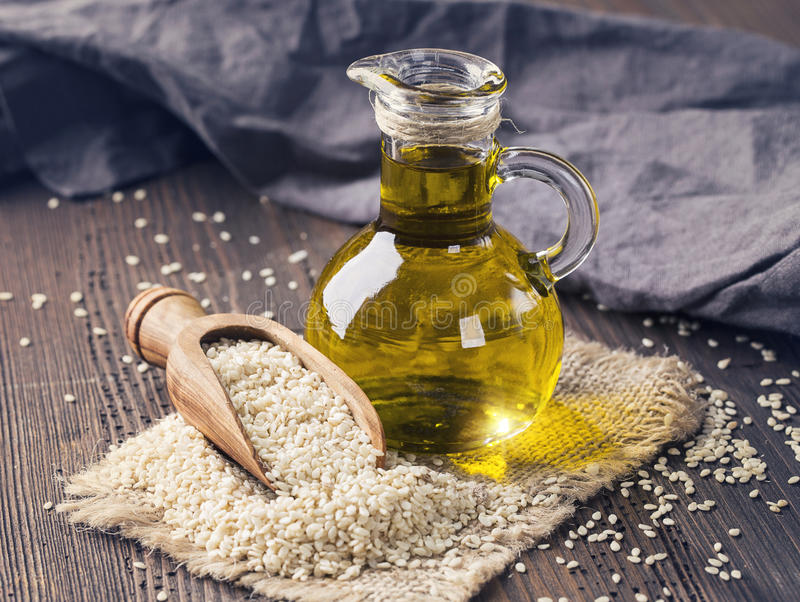 Sesame oil and seeds royalty free stock images