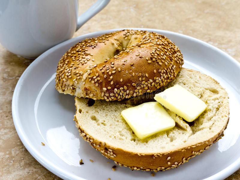 Download Sesame Seed Bagel With Butter Stock Photo - Image: 22995844