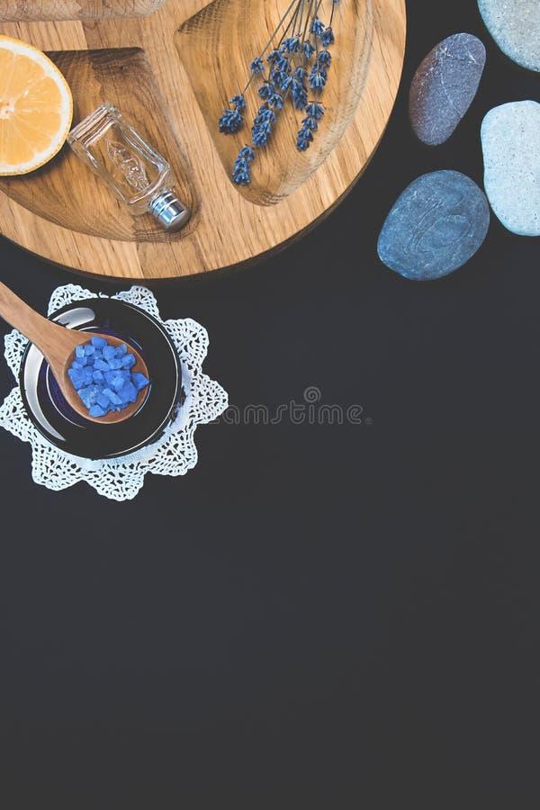 Seshels and seastones, bottles, lavender salts, lemon on the wooden round form. Seshels, lavender seasalt, seastones, decorative bottles, lemon on the wooden royalty free stock photography