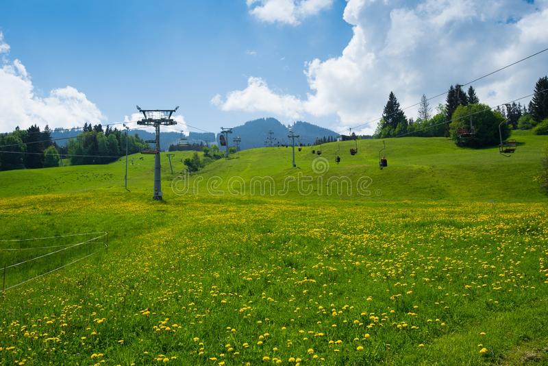 Chairlift in alps. Chairlift in hayfield in Alps, germany stock images