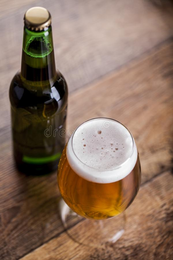 A glass with beer and foam royalty free stock image