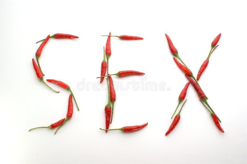 sesso di parola fatto con i peperoncini rossi caldi fotografie stock