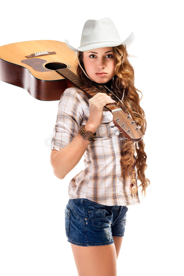 Sesy cowgirl in cowboy hat with acoustic guitar stock image