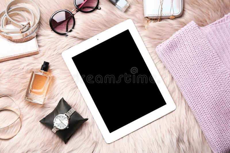 Set of accessories, perfume and tablet computer , flat lay. Beauty blogging royalty free stock photo