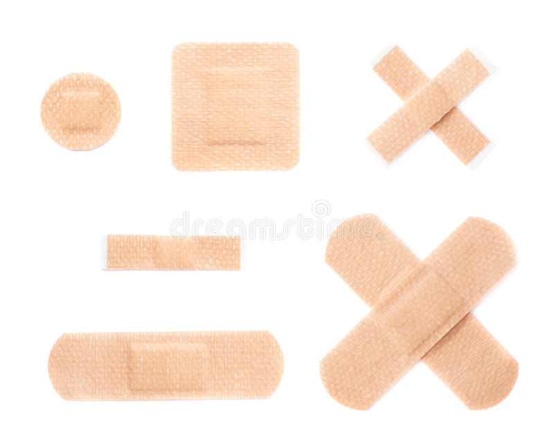 Set of adhesive bandage sticking plasters. Set of multiple different adhesive bandage sticking plaster compositions isolated over the white background royalty free stock photography