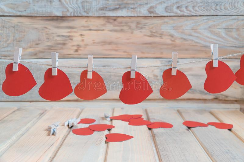 Set of Air Balloons. Bunch of red color heart shaped foil balloons on white background. Love. Holiday celebration. stock photo