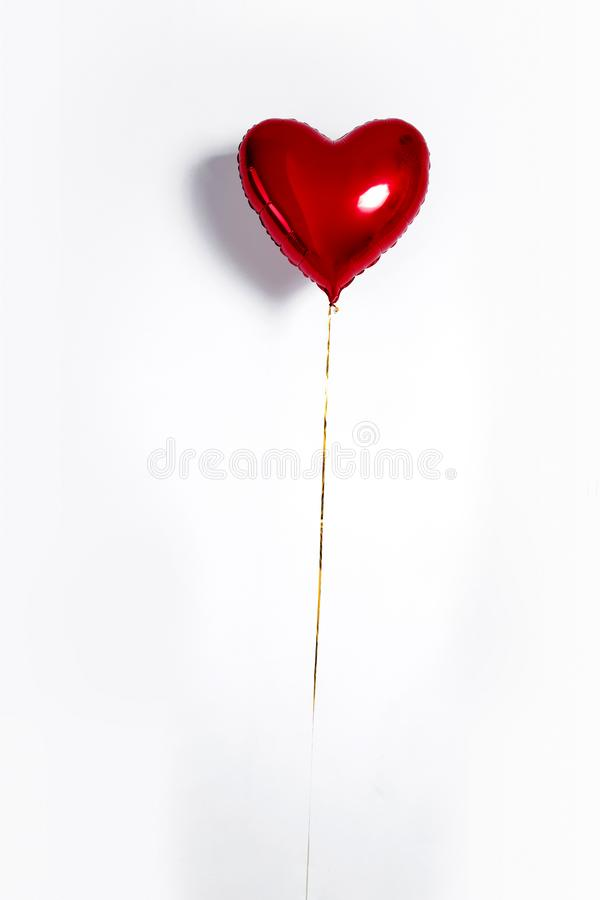 Set of Air Balloons. Bunch of red color heart shaped foil balloons isolated on white background. Love. royalty free stock photos