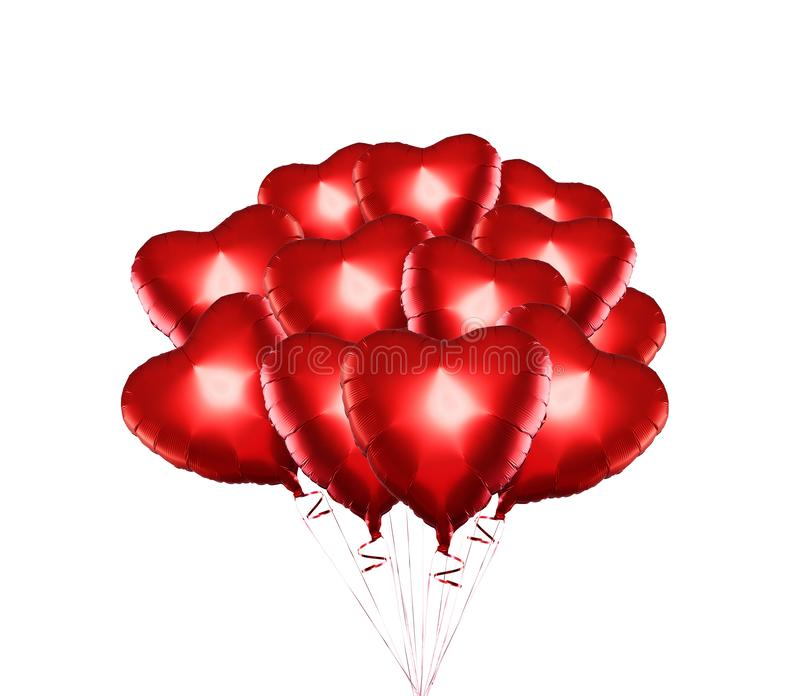 Set of Air Balloons. Bunch of red color heart shaped foil balloons isolated on white background. Love. Holiday celebration. stock photography