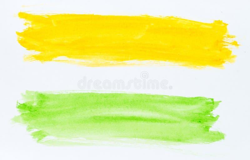 Set akwareli muśnięcia uderzenia zieleń i żółta farba na whi royalty ilustracja