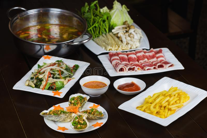 Set of Asian food with Fried Crispy Potato, Barbecue geoduck with onion and grease, Shrimp stir-fried vermicelli, hot pot with raw. Beef slide stock image