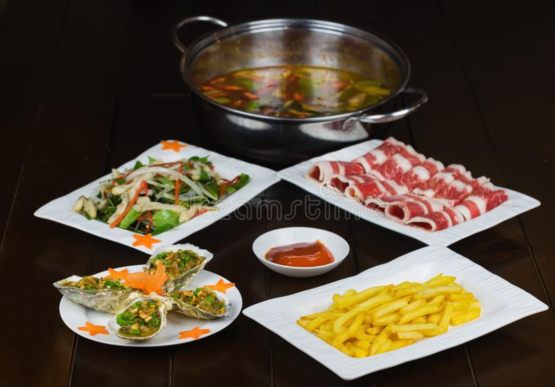 Set of Asian food with Fried Crispy Potato, Barbecue geoduck with onion and grease, Shrimp stir-fried vermicelli, hot pot with raw. Beef slide stock photos