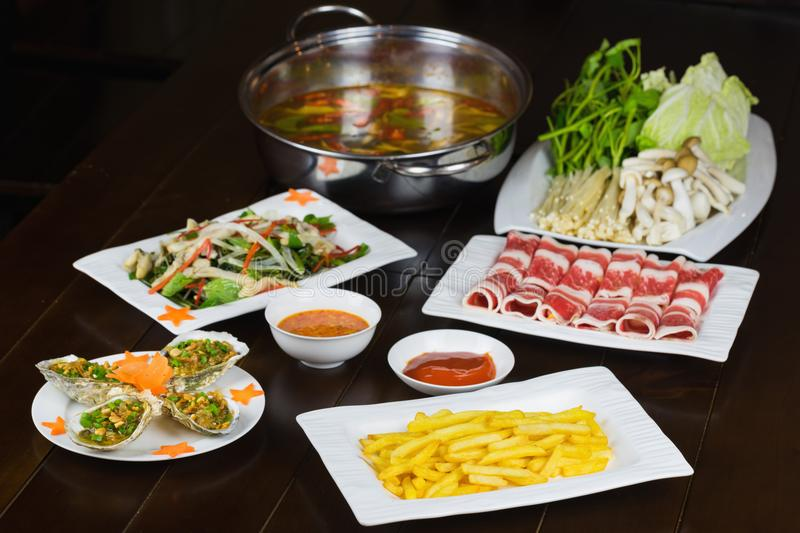 Set of Asian food with Fried Crispy Potato, Barbecue geoduck with onion and grease, Shrimp stir-fried vermicelli, hot pot with raw. Beef slide stock photo