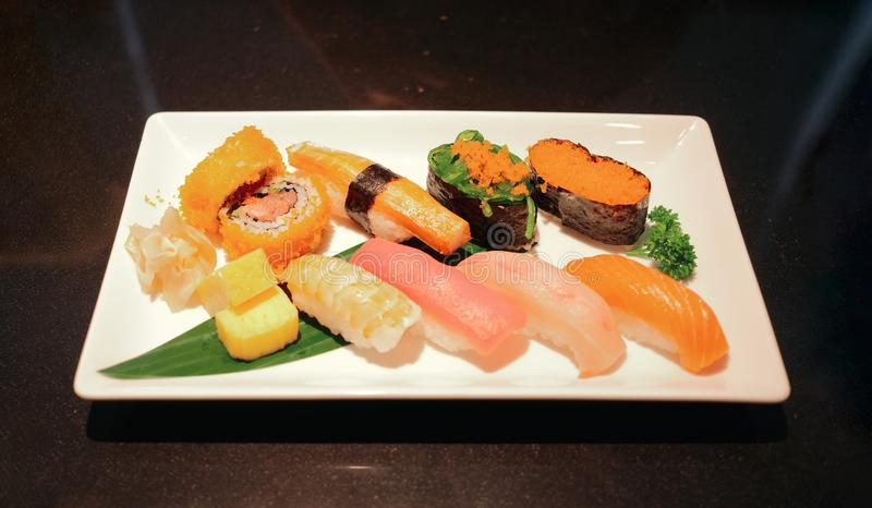 Set of assorted sushi, japanese food in restaurant ready to eat. Close up set of assorted sushi, japanese food in restaurant ready to eat from high angle view royalty free stock images