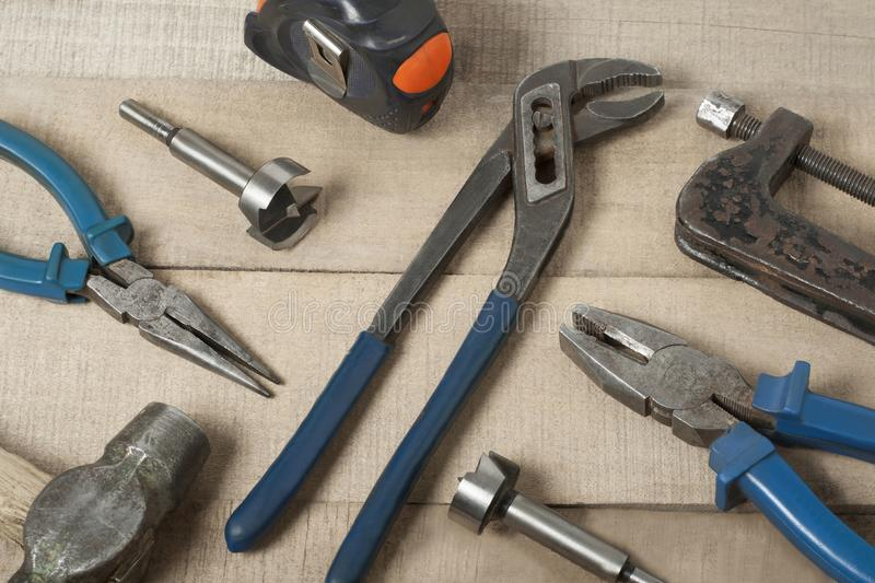 Set of different construction tools on wooden background.Construction concept. royalty free stock image