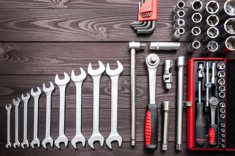 Set of auto tools on dark wooden workbench. copy space stock photo