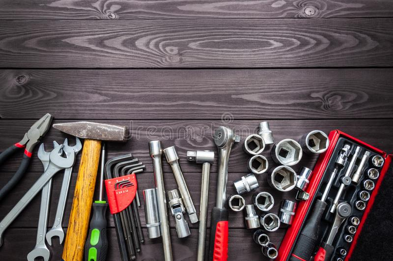 Set of auto tools on dark wooden workbench. copy space royalty free stock photo