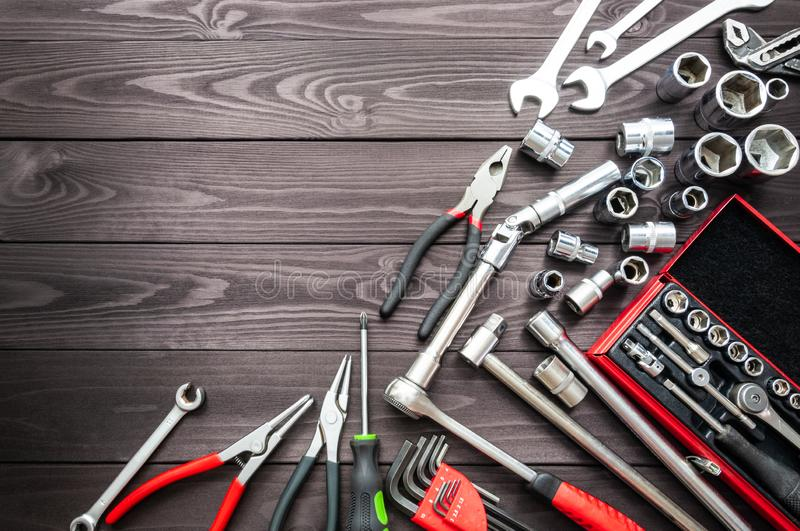 Set of auto tools on dark wooden workbench. copy space royalty free stock image