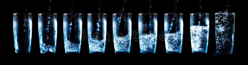 Set av exponeringsglas med vatten och is 图库摄影