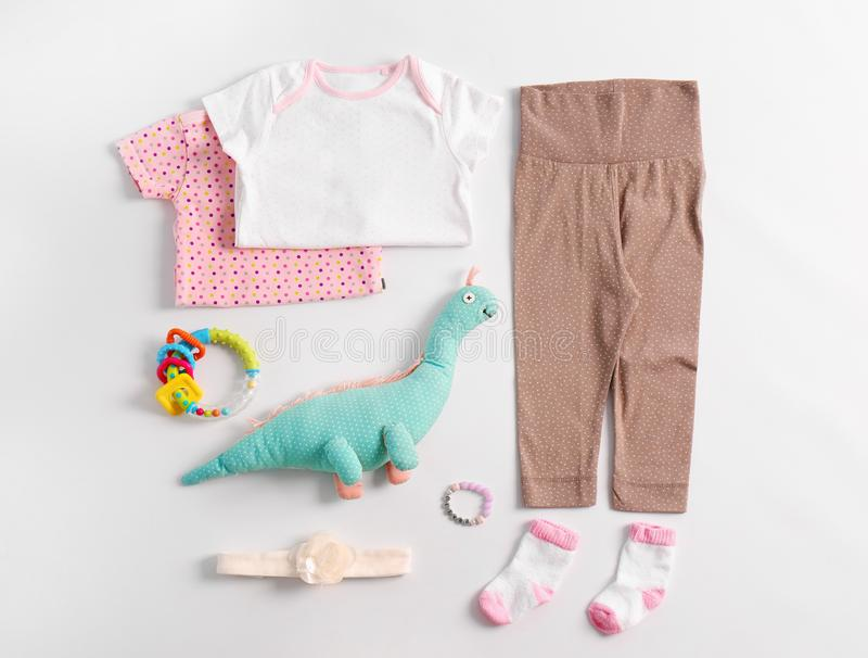 Set of baby clothes and accessories stock photos