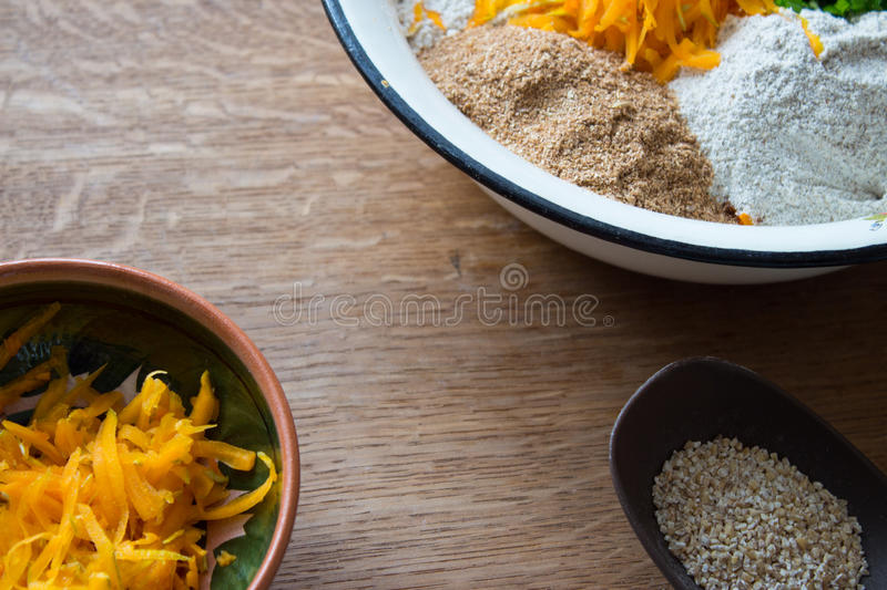 Set for baking rye bread on pumpkin and useful flour and seeds royalty free stock images