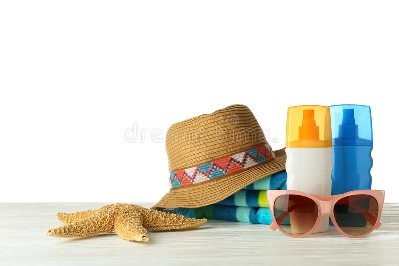 Set of beach accessories on table against white background. Space for text stock images