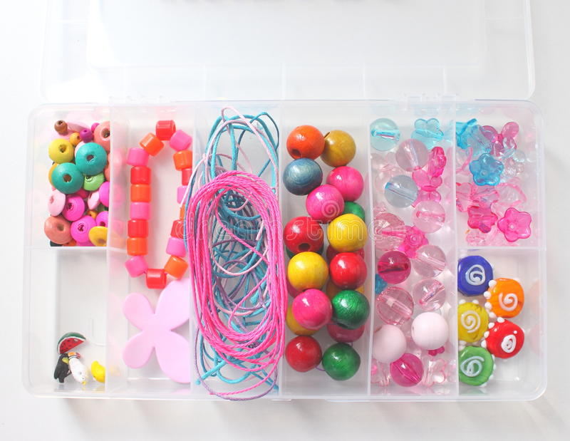 Set of beads. Set of colored beads in a box on a white background stock image