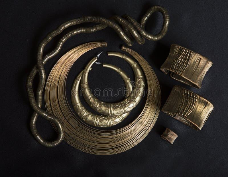 Set of Beautiful Oriental gold jewelry (Indian, Arab, African, E. Beautiful Oriental gold jewelry (Indian, Arab, African, Egyptian). Fashion Exotic Accessories stock photos