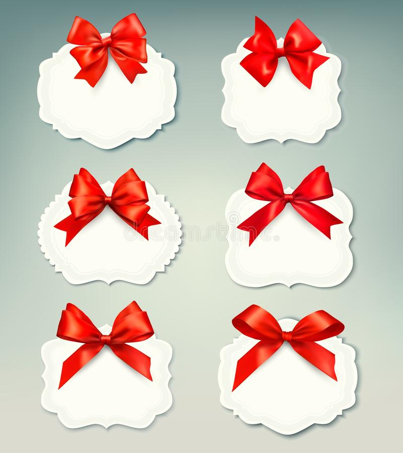 Set of beautiful retro labels with red gift bows w royalty free illustration